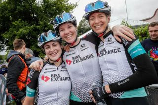 Sarah Roy (Team BikeExchange) with teammates Grace Brown and Lucy Kennedy after winning the elite women's road race at the Australian Road Championships