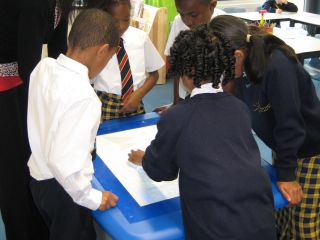 children at St.Matthew Academy, Lewisham, London using the Table