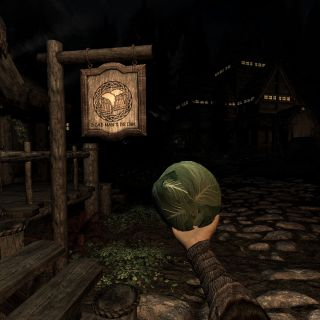 A cabbage being held in an armored hand in a modded game of Skyrim VR.