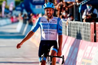Team Israel StartUp Nation rider Englands Alex Dowsett celebrates as he crosses the line for victory during the 8th stage of the Giro dItalia 2020 cycling race a 200kilometer route between Giovinazzo and Vieste on October 10 2020 Photo by Luca Bettini AFP Photo by LUCA BETTINIAFP via Getty Images