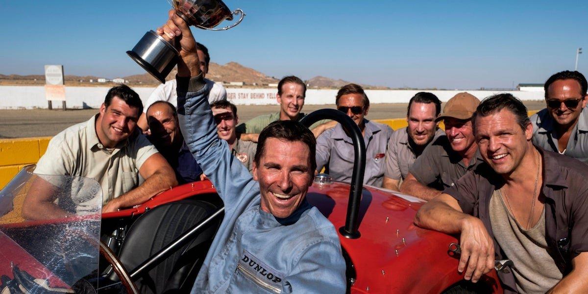 Christian Bale as Ken Miles holding a trophy in Ford v Ferrari