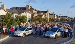 Photo of Mueller residents and researchers with Chevrolet Volt cars