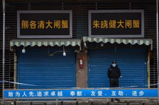 A security guard stands outside the Huanan Seafood Wholesale Market where the coronavirus was first detected in Wuhan in January 2020.