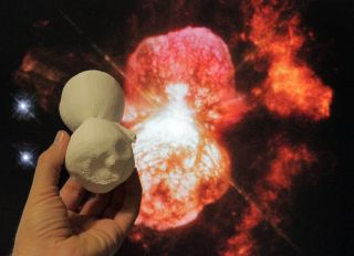 A 3D-printed model of the Homunculus Nebula is compared to a Hubble Space Telescope image of the object.