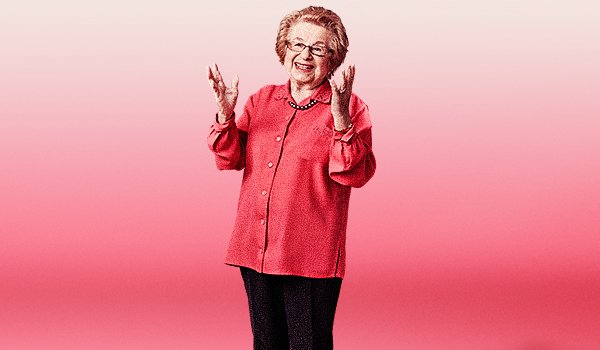 Ask Dr. Ruth the doctor stands in front of a pink background