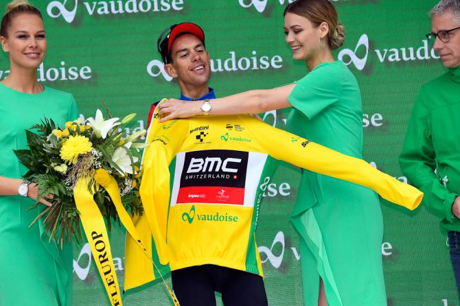 Richie Porte pulls on the Tour de Suisse leader's jersey after stage 5