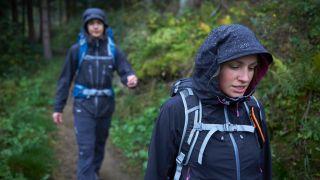 People trekking in waterproof jackets