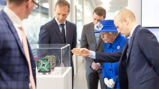 Queen Elizabeth II visited the Glasgow factory of satellite company Spire.