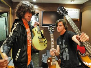 Gibson aficionados Josh Martin and Tony Smith show off the tools of their trade