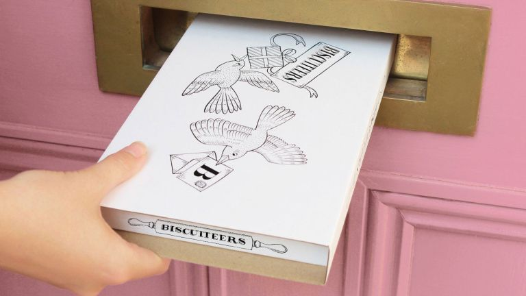 Easter gifts: Biscuiteers package going through pink door letterbox
