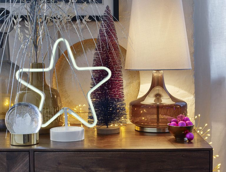 John Lewis lighting: neon star light on a festive side table