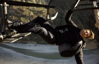 Tom Cruise hanging from a helicopter