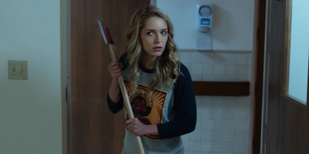 Jessica Rothe holding axe in Happy Death Day 2U