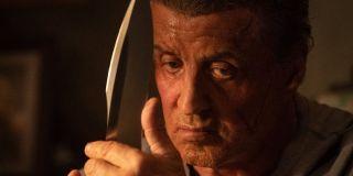 Rambo feeling the blade of his knife