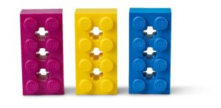 Three Lego bricks: purple, yellow and blue