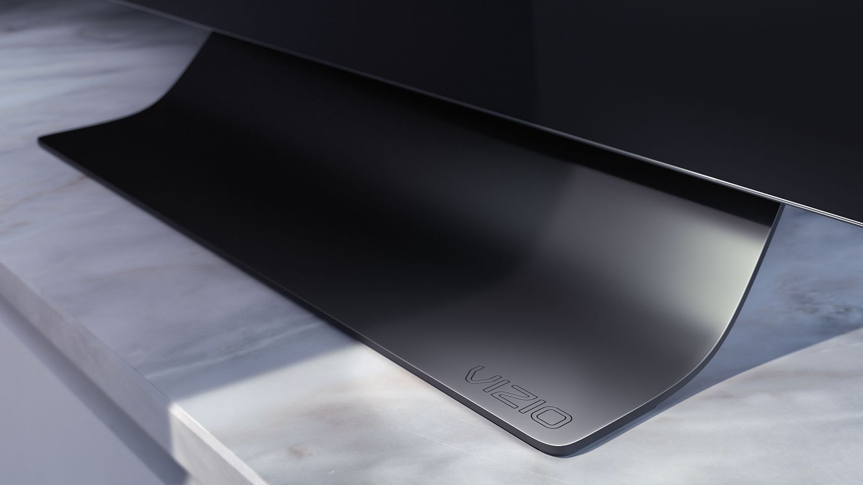 The curved stand of the Vizio OLED TV