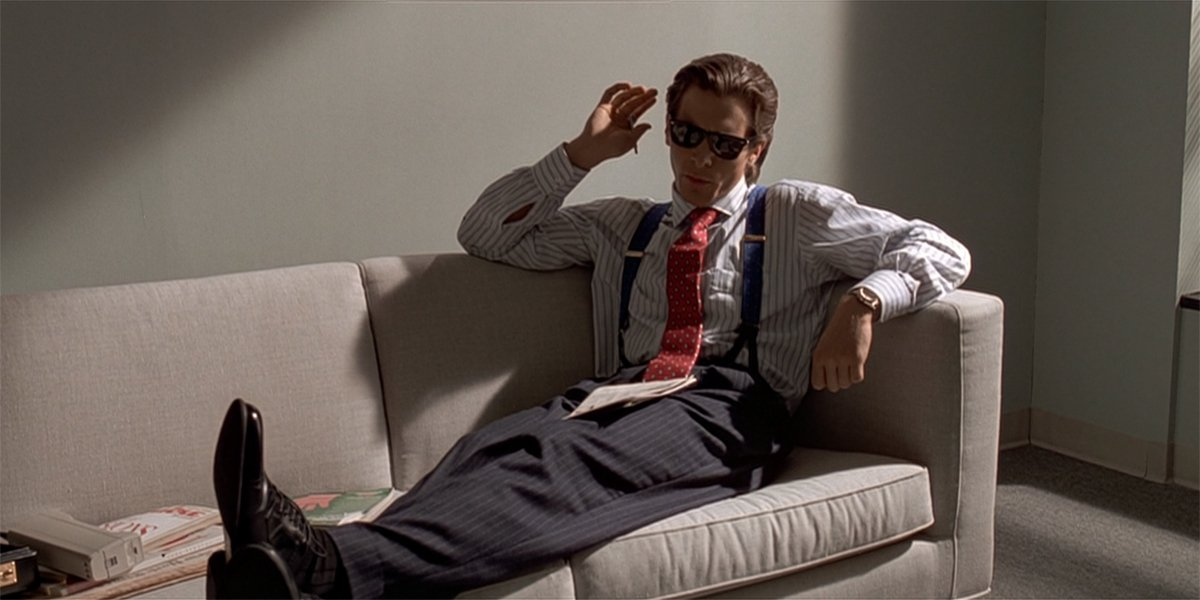 American Psycho Christian Bale as Patrick Bateman on the couch
