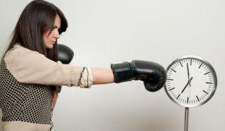 Woman boxing a clock
