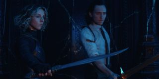 Sylvie (Sophia Di Martino) and Loki (Tom Hiddleston) are armed and ready in Loki (2021)