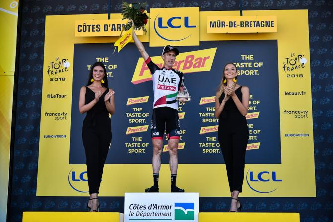 Dan Martin on the Tour de France podium after winning stage 6