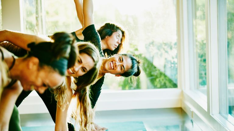 Group of women stretch together