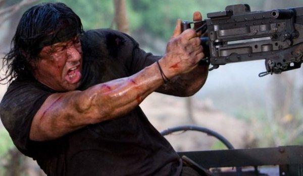 Rambo (2008) John Rambo firing a mounted machine gun intensely