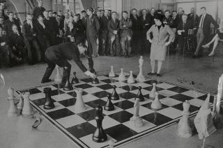 Nona Gaprindashvili of the Soviet Union, pictured playing a game of chess at the International Chess Congress in London on 30th December 1964.