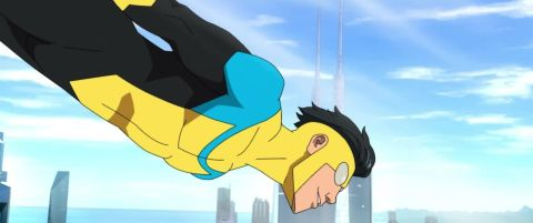 The superhero known as Invincible flies through the skies in front of a cityscape