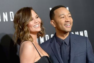 "Model Chrissy Teigen and husband John Legend at the season 2 premiere of WGN America's ""Underground"" screening on March 1, 2017, in Westwood, California."