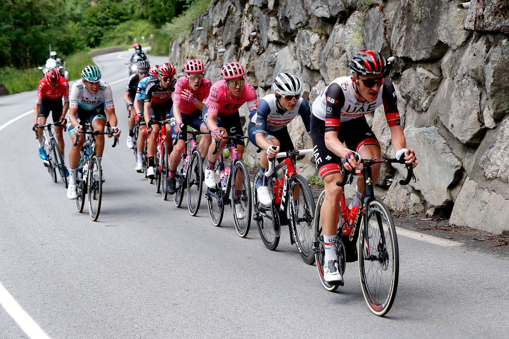 LA PLAGNE FRANCE JUNE 05 Mikkel Bjerg of Denmark and UAE Team Emirates Kenny Elissonde of France and Team Trek Segafredo Lawson Craddock of United States and Team EF Education Nippo Michael Valgren Andersen of Denmark and Team EF Education Nippo Steff Cras of Belgium and Team Lotto Soudal Matthew Holmes of United Kingdom and Team Lotto Soudal Polka Dot Mountain Jersey Martijn Tusveld of Netherlands and Team DSM Warren Barguil of France and Team Arka Samsic Nils Politt of Germany and Team Bora Hansgrohe in the chase group during the 73rd Critrium du Dauphin 2021 Stage 7 a 1715km stage from SaintMartinLeVinoux to La Plagne 2072m UCIworldtour Dauphin dauphine on June 05 2021 in La Plagne France Photo by Bas CzerwinskiGetty Images