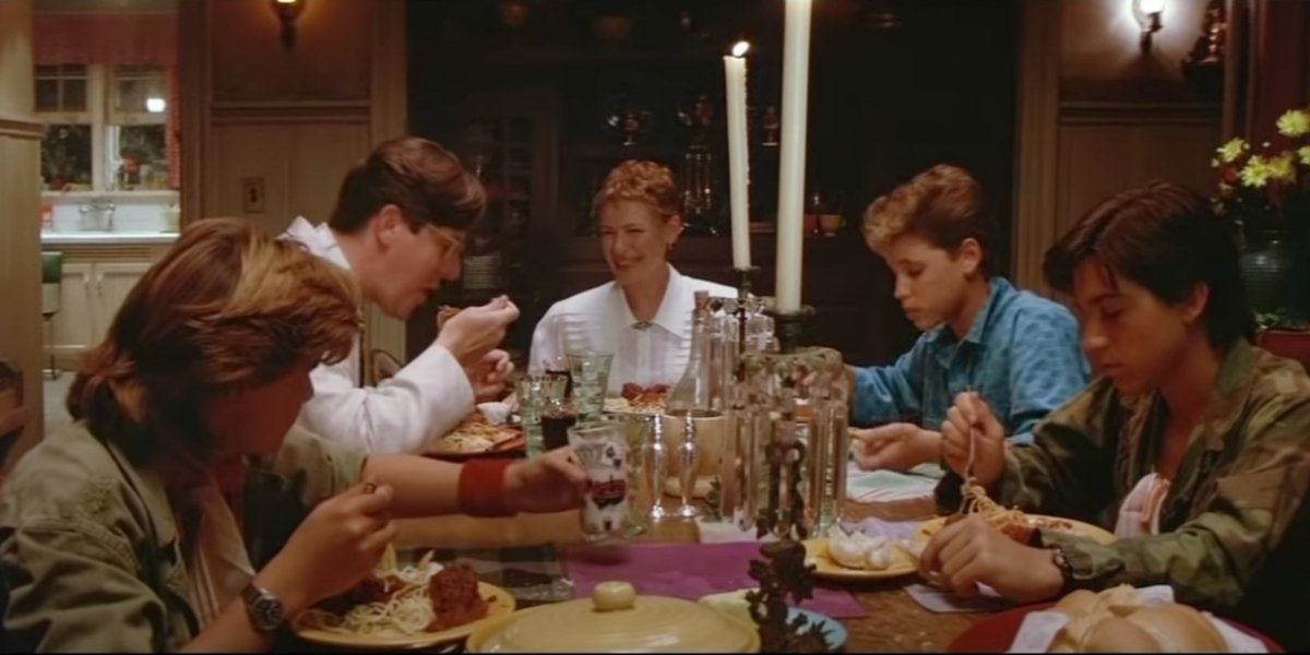 Corey Feldman, Edward Hermann, Dianee Wiest, Corey Haim, and Jamison Newlander in The Lost Boys