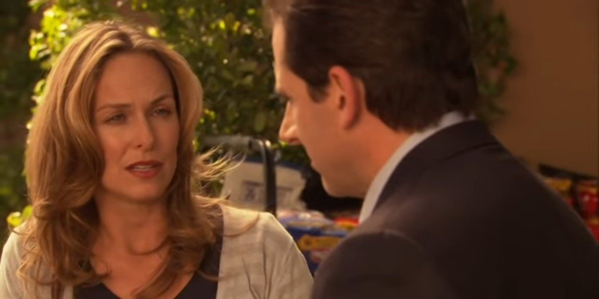 Michael and Jan talking in the supermarket parking lot on The Office