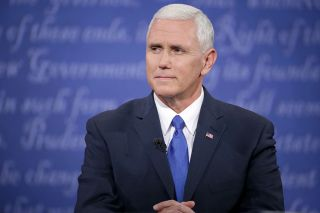 Mike Pence, U.S. vice president, listens during one of the vice presidential debates in October 2016.