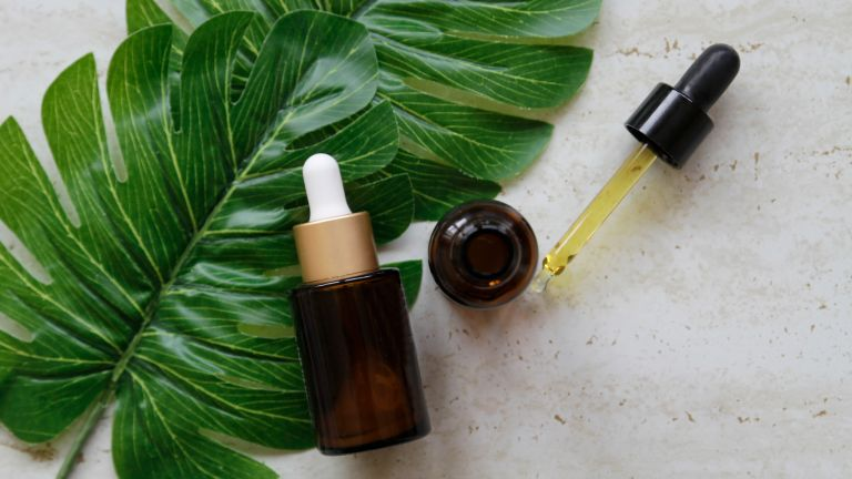 two serum bottles flat lay with leaf