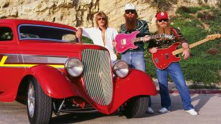 Portrait of the three members of ZZ Top with their 'Eliminator' hot rod