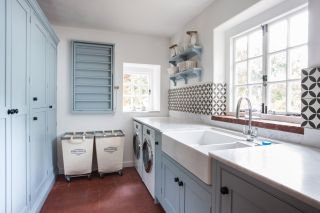 small utility room ideas including a pull down drying rack