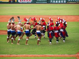 aboriginal taiwanese dance at a baseball game.