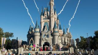 The remnants of fireworks can be seen behind Cinderella's castle during a performance at Disney World.