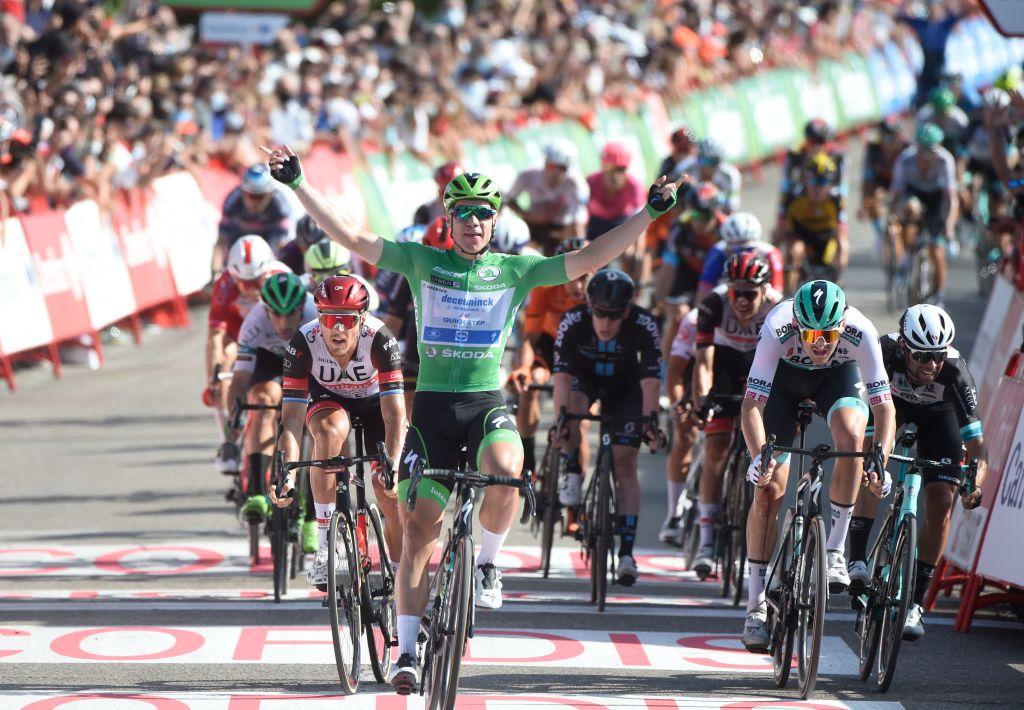 Team Deceunincks Dutch rider Fabio Jakobsen C celebrates as he wins the 16th stage of the 2021 La Vuelta cycling tour of Spain a 180 km race from Laredo to Santa Cruz de Bezana on August 31 2021 Photo by MIGUEL RIOPA AFP Photo by MIGUEL RIOPAAFP via Getty Images