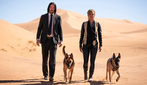 Keanu Reeves and Halle Berry and Sofia dogs in John Wick Chapter 3 Parabellum