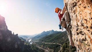 how to train for climbing: climber on crag