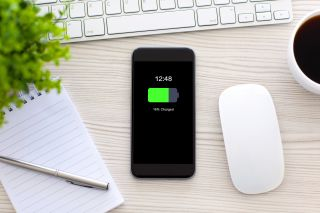 Shutterstock image showing a smartphone wirelessly charging