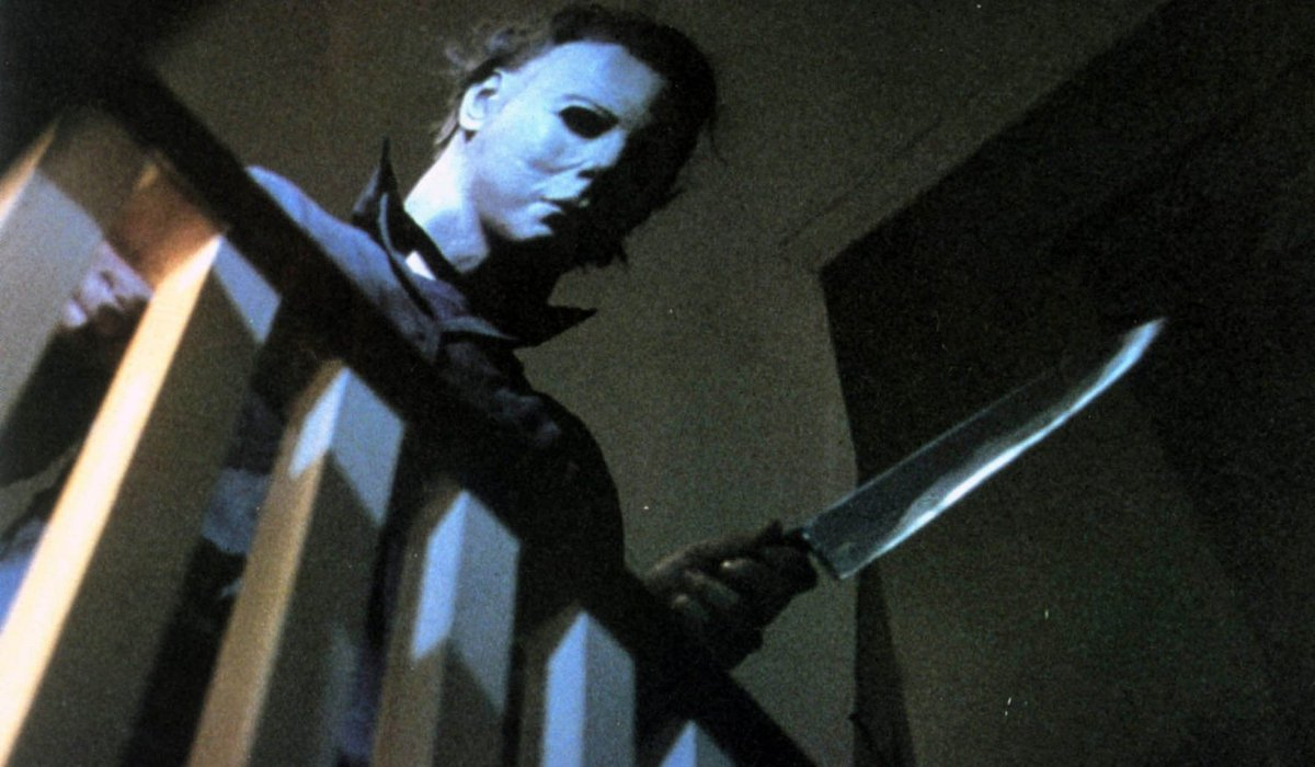 Halloween Michael Myers wielding a knife by the railing
