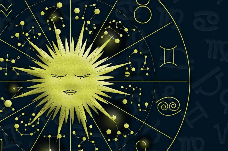 Yellow circle signs on blue background, in Trento Italy - When is Leo season