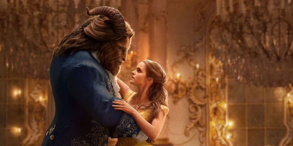 The Beast and Belle embrace as they dance in a promotional image for 'Beauty and the Beast'