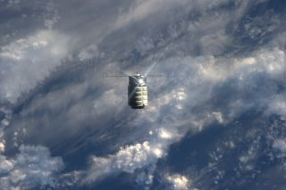Orbital Sciences' first Cygnus spacecraft is seen nearing the International Space Station in this photo taken by an astronaut aboard the orbiting lab on Sept. 29, 2013, during the spacecraft's first rendezvous.