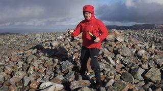 Hazel celebrates on a mountain