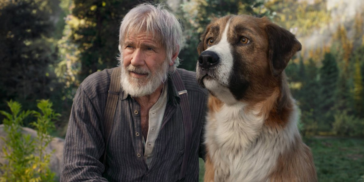 The Call of the Wild Harrison Ford sits next to Buck in the wild