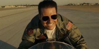Top Gun: Maverick Tom Cruise riding his bike with a smile