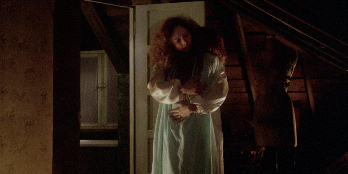 Margaret White (Piper Laurie) hugs Carrie (Sissy Spacek) in Carrie